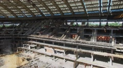 Stock Video Footage of People work on construction site of soccer arena Luzhniki