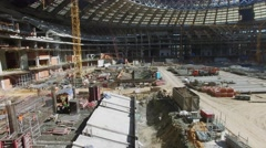 Stock Video Footage of People work on construction site of football arena Luzhniki