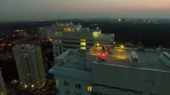 Several people get fun on roof of residential complex Stock Footage