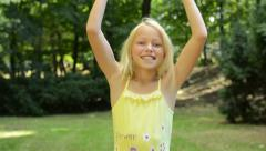 Little girl rejoices in the success like a winner - eye contact  Stock Footage