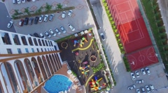 Playgrounds and pool among edifices of residential complex Stock Footage