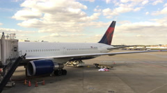 Delta Airlines plane at airport boarding at terminal 4k Stock Footage