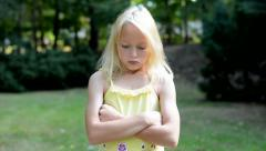 little girl offends in the park - she based her arms and pouting her lips - eye  - stock footage