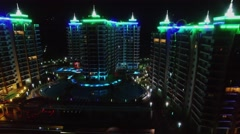 Azura Park hotel with colorful illumination at night. Aerial view Stock Footage