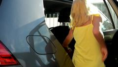 little girl gets in the car - she open and slam the car door - close up - stock footage