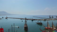 Many touristic vessels in Alania Sea Port at summer sunny day Stock Footage