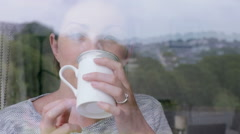 Stock Video Footage of Thoughtful woman enjoying a coffee