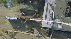 Building site with worker which use concrete from long tube Stock Footage