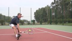Tennis player uses backhand slice  and than moving to the net. Slow motion - stock footage