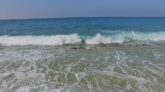 Froth of sea waves and people which swim under blue sky Stock Footage