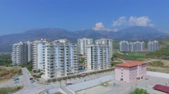 Residential complex and Azura Park hotel against mountains at summer Stock Footage