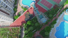 Pools and tennis courts at summer sunny day. - stock footage