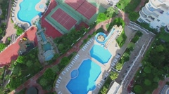 Tennis courts and pools among residential edifices at summer Stock Footage