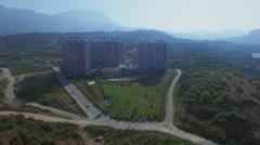 Azura Park hotel among farm fields near mountain at summer Stock Footage
