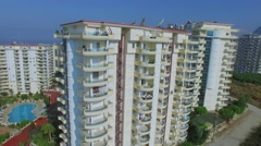 Dwelling complex with pool and tennis courts in city on sea shore - stock footage