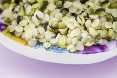 Healthy edible hemp seeds with a coarse grind Stock Photos