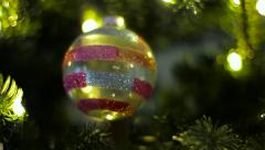 Stripped Christmas Ball On Tree Stock Footage