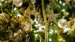 Gold and Silver Oranments On Christmas Tree - stock footage