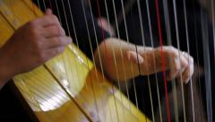 Harp Plucking Stock Footage