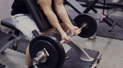 Man working arms  gym, lifting bells, slow motion Stock Footage