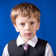 Portrait of the boy of the blonde with blue eyes - stock photo