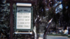 1949: Rancho Santa Fe city tour area buildings southern california style. RANCHO Stock Footage