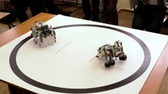 Hand made robots fight in sumo ring Stock Footage