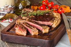 Beef steaks with grilled vegetables and seasoning - stock photo