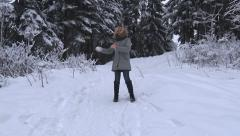 Girl Makes and Throws Snowball - stock footage
