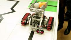 DIY hand made robot model of Tractor transporting plastic balls Stock Footage