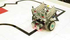 Programmed toy wagon moving along the leased line. DIY hand made model. Stock Footage
