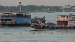 2 Ferry boats passing on Mekong river,Phnom Penh,Cambodia Stock Footage