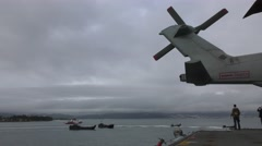 Helicopter and Portuguese amphibious assault Landing Crafts - stock footage