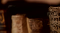 Ancient books on a bookshelve Stock Footage