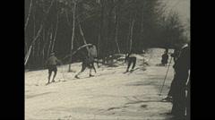Vintage 16mm film, 1934, Winter life, Pocono inn sports b-roll going uphill Stock Footage