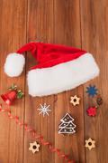 Christmas balls Cookies Santa hats on a wooden table. Stock Photos