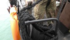 A sailor ties a rope and makes a knot Stock Footage