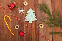 Gingerbread cookies and Christmas balls on wooden table. - stock photo