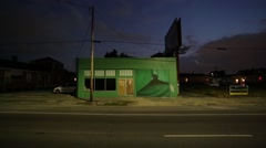 Green building at night St Claude Ave, New Orleans Stock Footage