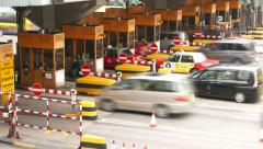 Traffic through toll gate before paid road, close side view, time lapse Stock Footage