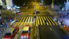 Pedestrian crossing against street intersection, top night view, time lapse Stock Footage