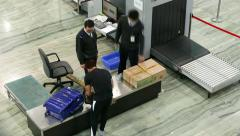 Manual inspection at airport, boy take out small item from suitcase. Time lapse Stock Footage