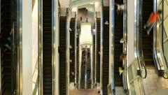 Multiple escalators from above, people travel up and down, time lapse Stock Footage