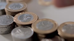 Hands put a Brazilian Coins at table Stock Footage