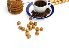 Linking of oatmeal cookies, cup of coffee, coffee grains and nutlets Stock Photos