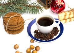 linking of cookies, fir-tree branch, cup of coffee, coffee grains and nutlets - stock photo