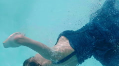 Beautiful woman swimming underwater Stock Footage