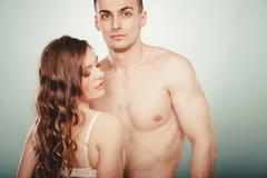 Stock Photo of Sexy couple. Half naked man and woman in lingerie.