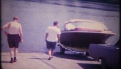 3015 launching boat from trailer for day on the water -vintage film home movie - stock footage