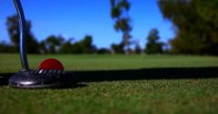 Orange golf ball hit Stock Footage